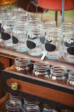 chalkboard mason jars for guests to write their initials on for the evening