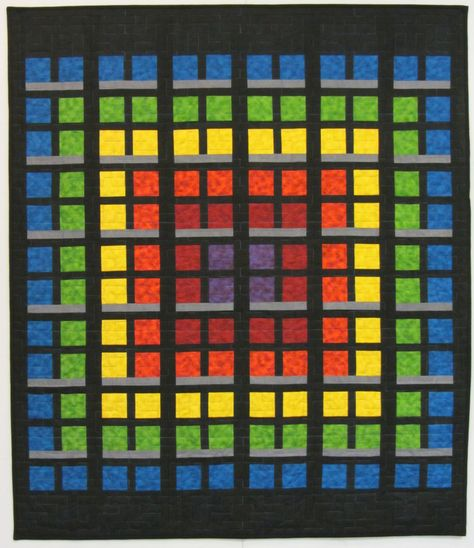 Urban Lights quilt pattern by Ryan Clayton.  This has the appearance of Attic Windows but it is a straight piecing pattern.