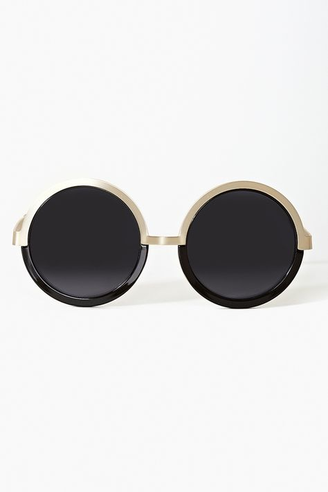 d054d761bc Ah-mazing oversized circle shades featuring a black and matte gold frame.  Dark gray lenses