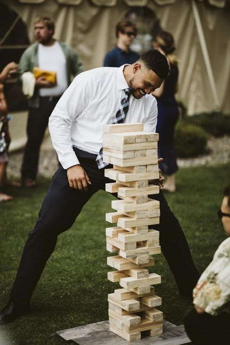 Outdoor wedding reception entertainment with large jenga