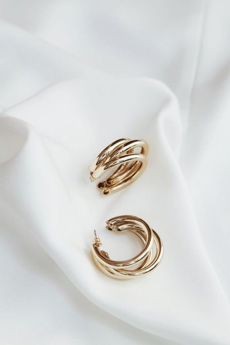 Style fit Tola Earrings (Gold) DETAILS SIZING & CARE A statement style earrings, wear them with your finest attire or with your favorite jeans! - Gold-plated alloy FIT- One SizeCARE - Keep jewelry dry at all times, always avoid contact with chemicals.