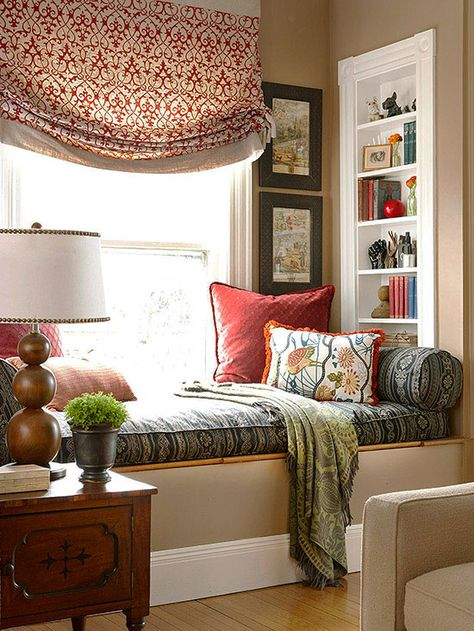We love the rich, warm colors in this window seat! Click through for more pictures: http://www.bhg.com/home-improvement/windows/built-in-window-seat/?socsrc=bhgpin091214addamenities&page=2