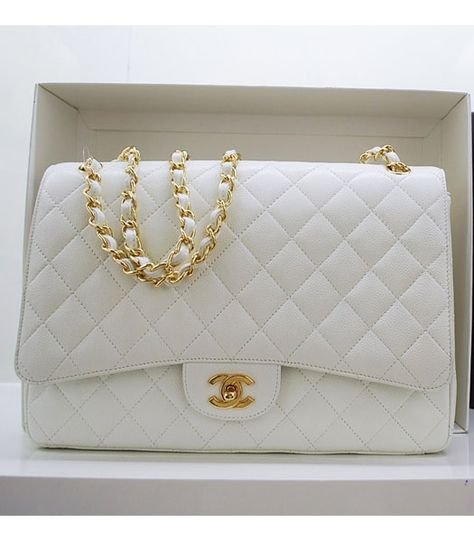 """White """"Chanel"""" Classic Flap Bag. In the 1920s, Coco Chanel became tired of having to carry her handbags in her arms and decided to design a handbag that freed up her hands. Inspired by the straps found on soldiers' bags she added thin straps.. http://www.luxurybuyers.com"""
