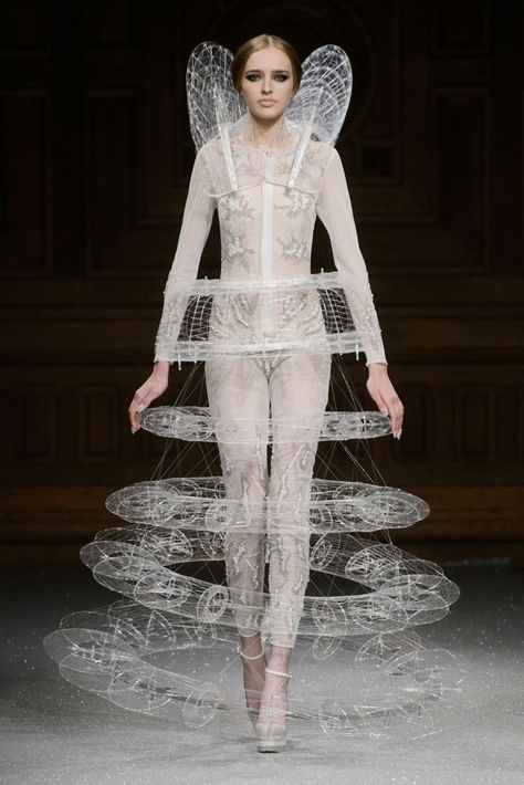 floating ring illusion dress with elaborate 3D structure and intricate threadwork/ Oscar Carvallo