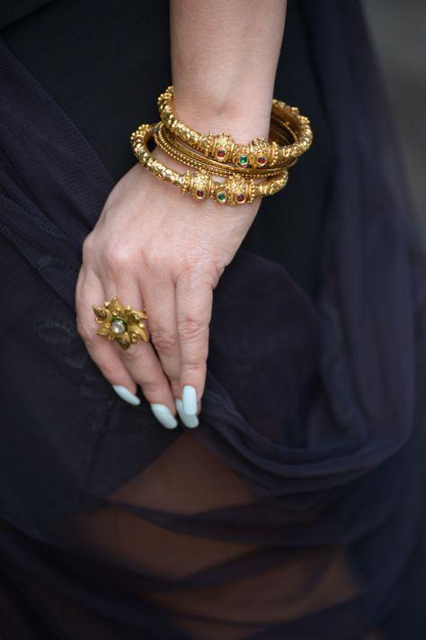 Ugly nailz but i like the traxitional Gold Bangles by Waman Hari Pethe Jewlers