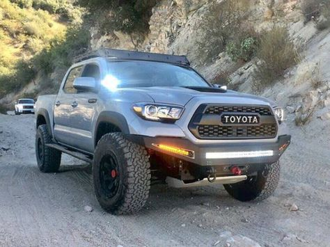 With An Aggressive Style The Honeybadger Front Bumper For The Toyota Tacoma Gives Your Truck A Tough Toyota Tacoma Accessories Toyota Tacoma Toyota Tacoma Trd