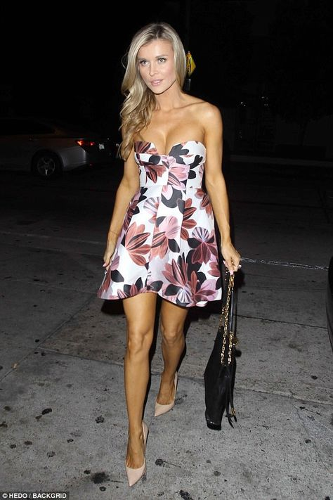 Looking good: Joanna Krupa stepped out in a strapless low-cut floral-patterned frock Monday night as she headed to Catch in West Hollywood