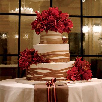 The center of seduction: confectionary queen Sylvia Weinstock's chocolate wedding cake with chocolate mousse and raspberry confit, wrapped in sugar ribbons and topped with raspberry and cocoa-colored sugar flowers.