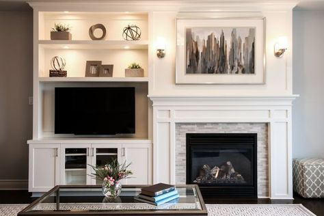 A built-in shelving unit creates balance with an off-center fireplace.: