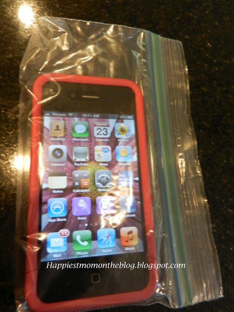 When ever we go to the pool or beach, I place my phone in a snack size ziplock baggie.  I can still use my phone through the plastic with my wet sandy hands...why haven't I thought of this!!