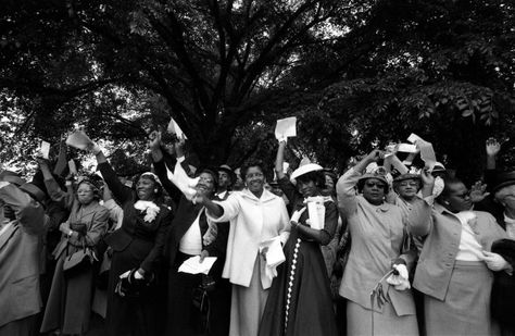 """Women wave their arms in approval at the Prayer Pilgrimage in Washington, D.C. on May 17, 1957. Though young people on the Freedom Rides would later become the face of the civil rights movement, transforming message into strategic action, it was """"church ladies"""" like these — and like Rosa Parks, who kicked off the Montgomery Bus Boycott and attended the pilgrimage — who provided its spiritual backbone."""