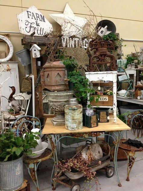 Display use galvanized stuff/ butter churns with weeds/ nail bins as shelves..mmm