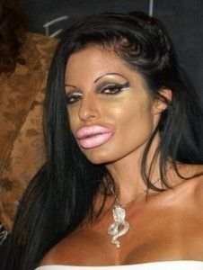 Plastic surgery fails - photo courtesy of tumblr.......Is this REALLY the look she was going for??? She looks like something (I don't know what really) that you would stick to the inside of a car rear window looking out......