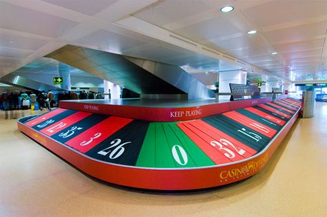 A funny photo of a clever advertising effort to change a baggage claim into a reminder of how much fun poker is!