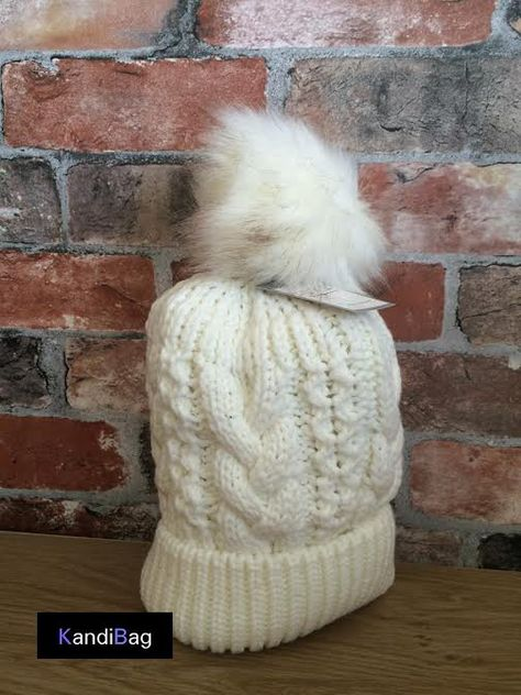 Ladies Cream Faux Fur Chunky Cable Knit Winter Hat With PomPom Bobble  winter Beanie Keep warm and cozy this winter with these stylish pompom  beanie hats ... 3576b5cc7ec5