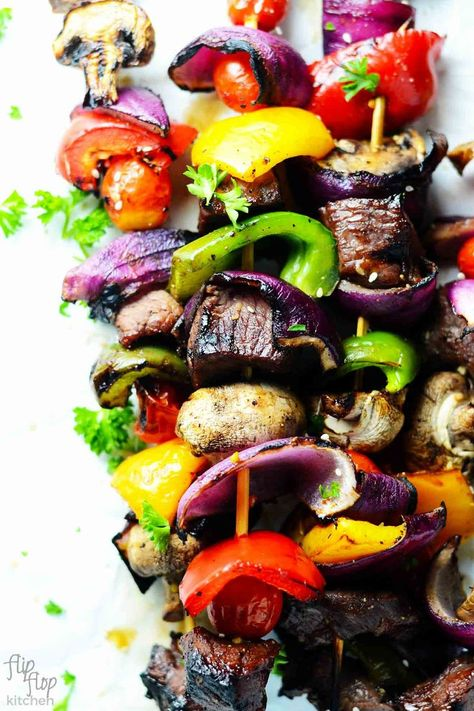 Perfectly Grilled Shish Kabobs- These shish kabobs will have your mouth bursting with flavor and leave your soul begging for more. Wrinkly grilled grape tomatoes, tender-crispy-crunchy- bell peppers, marinated steak, GORG red onions, and succulent juicy mushrooms, all put on a skewer and grilled to perfection. | flipflopkitchen.com