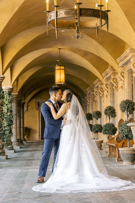 This happy couple shares a kiss in our stunning courtyard. The architecture of our barrel vaulted eaves in the hallways make for an amazing backdrop for wedding day. | Villa Siena | Leslie Ann Photography | #Villasiena #weddingvenue #gilbertarizona #arizonaweddings #arizonaweddingvenue #theromantickiss #weddingphotoideas #weddingposeideas #weddingposes #theromantickiss #couplesphotos #husbandandwife #brideandgroom