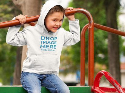Download Placeit Little Boy Wearing A Hoodie At A Park Mockup Oval Logo Youth Hoodies Kids Hoodie