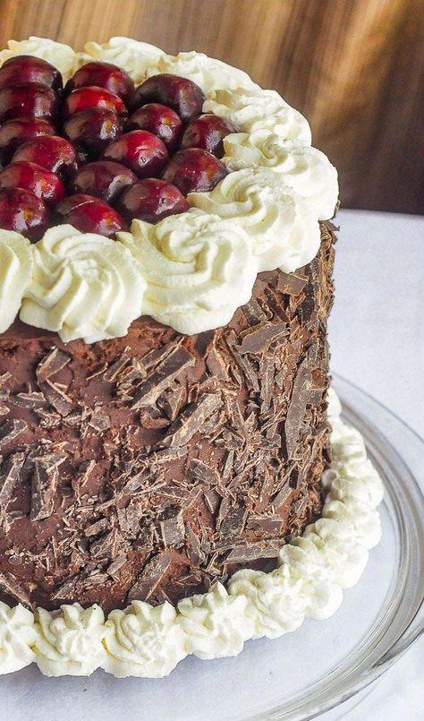 Double Chocolate Black Forest Cake. An ideal celebration cake! Chocolate fudge cake filled with layers of whipped chocolate ganache, fresh sweet cherries and vanilla whipped cream.#birthdaycake #anniversarycake #celebration cake #blackforestcake  #cherrycake #chocolatecake
