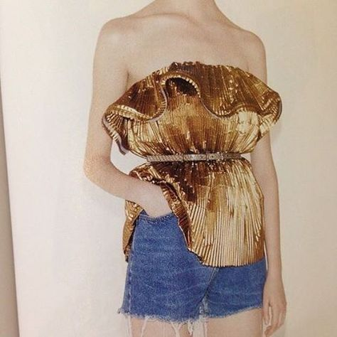 Hi-lo styling and metallics continue to dominate festival looks for summer... Experiment with gold, ruffles and pleats but pair with casual denim cut-offs for a daytime look. Image via i-d. Womenswear weekend by @laura_wgsn