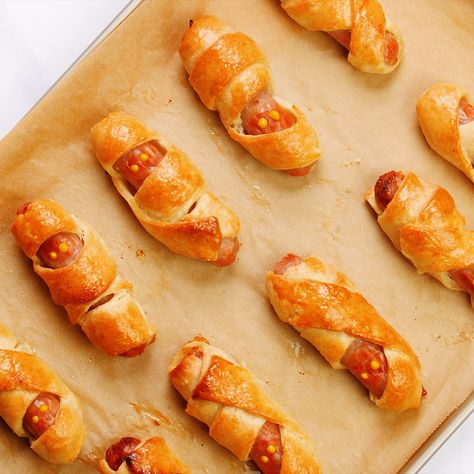 Served hot or cold, these spooky mummy sausage rolls are essential for any Halloween party. It's the scariest party food we've ever seen! #halloweenfood #partyfood #sausagerolls