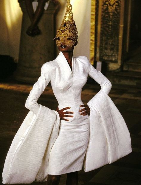 Givenchy Haute Couture---like the dress not the bottom part of the sleeves so much but that's a good pose for crazy sleeves.