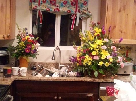 Does my dirty kitchen look better with these beautiful bouquets?