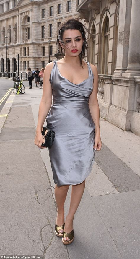 Charli XCX ups glamour in grey satin gown at fashion