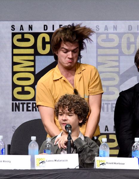 "Joe Keery Photos Photos - Actors Joe Keery (top) and Gaten Matarazzo attend Netflix's ""Stranger Things"" panel during Comic-Con International 2017 at San Diego Convention Center on July 22, 2017 in San Diego, California. - Comic-Con International 2017 - Netflix's 'Stranger Things' Panel"