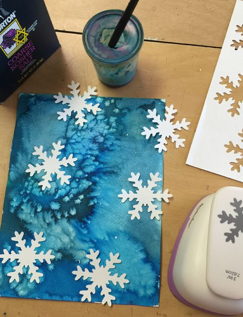 Sprinkle salt on a wet watercolor painting, let dry and add punched paper snowflakes. #artprojectsforkids #snowflakes