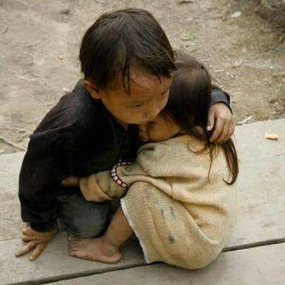 Nepal, hope remains as this brother comforts his sister after the devastating  earthquake that killed thousands.