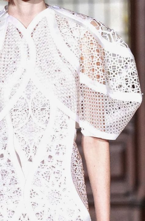 White dress with oversized sleeves & intricate laser cut patterns;