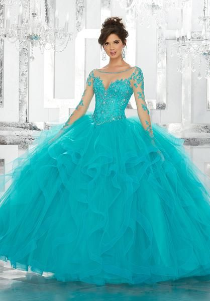 Look elegant in this beaded long-sleeved illusion dress by Mori Lee Vizcaya Style Number 89142 during your Quinceanera, Sweet 16 party, or for any formal event. This gorgeous Quinceañera ballgown features a beaded and embroidered bodice accented with an illusion neckline and long illusion sleeves. A matching stole is included. Mori Lee Vizcaya Collection Colors: Champagne/Blush, Black Cherry, Blue Capri, White Please allow 4 - 5 months for delivery because Mori Lee Vizcaya Quinceanera ...
