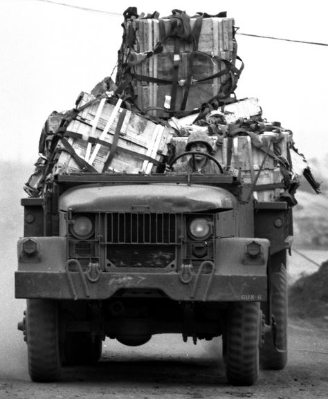 John Olson ©Stars and Stripes South Vietnam, March, 1968: A truck brings supplies dropped from a C-130 transport plane to besieged Marines during the 77-day battle at the Khe Sanh combat base, near the Laotian border.