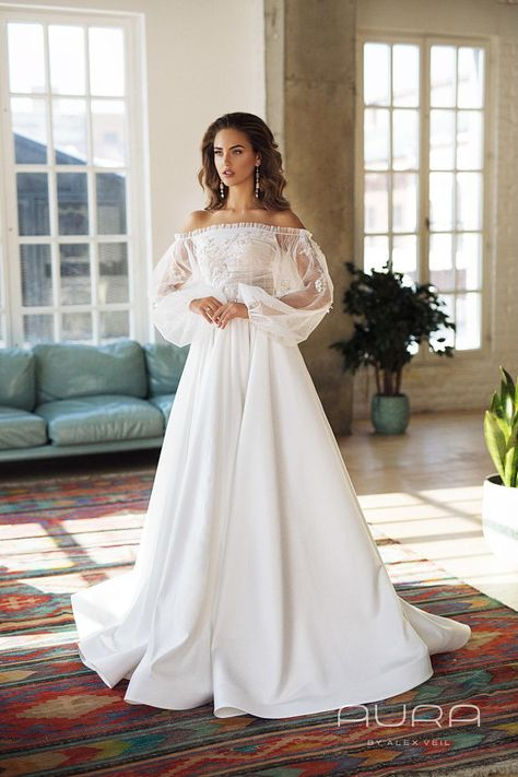 Wedding dress 'Brigitte' from the new AURA line by AlexVeil Bridal, with beautiful off shoulder balloon sleeves, classical satin skirt and beautiful handmade detailing