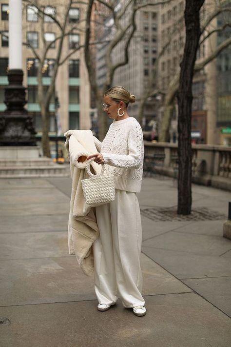 Winter whites // Blair Eadie wearing pearl accessories and a faux fur coat // Click through to Atlantic-Pacific for full outfit details and more faux fur coats for the season