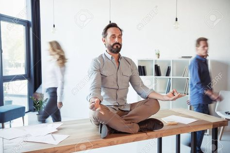 Relaxed businessman meditating in lotus position while coworkers moving , #Ad, #meditating, #businessman, #Relaxed, #lotus, #moving