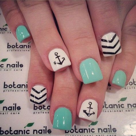 Another win for the short square nails! This is a cute and quirky nail art design that cute lovers will adore. The nails are coated with sea green and white matte and topped with black details; drawing out anchors and v-shaped Chevron lines to further acc
