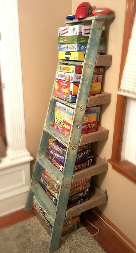 11 Surprising Ways To Reuse Your Household Clutter - this is a great way to get . 11 Surprising Ways To Reuse Your Household Clutter – this is a great way to get the games out of Ladder Shelf Diy, Old Ladder, Wooden Ladder, Ladder Storage, Vintage Ladder, Stair Storage, Ladder Decor, Board Game Storage, Board Game Organization