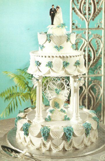 This traditional wedding cake has two toppers, one in between the two layers and one on the top.