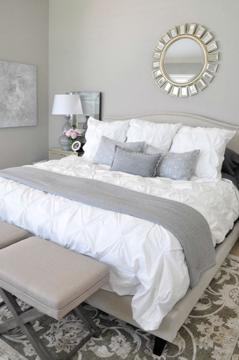 A different view of this bedroom. That white, fluffy comforter looks soooo cozy. Walls are 'New Gray ' by Sherwin-Williams. Gorgeous rug is from Joss & Main  ....    neutral master bedroom, white bedding with neutral rug grey accents, abstract art