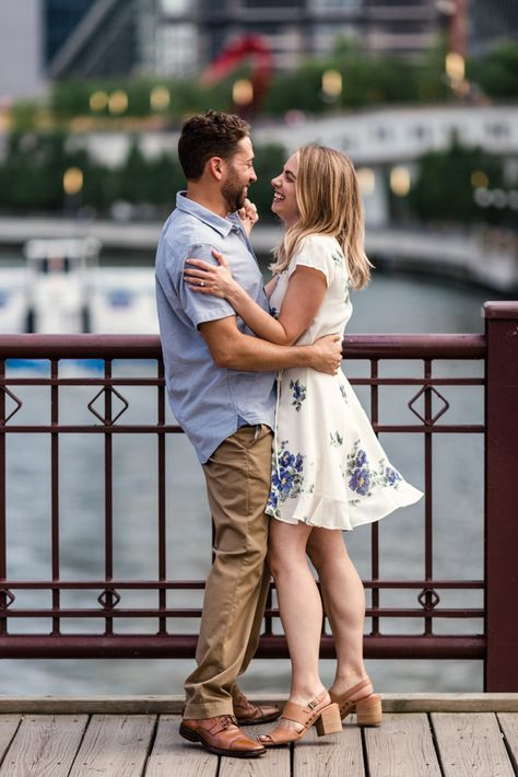 Couple dance on Kinzie Bridge during their summer Chicago engagement session