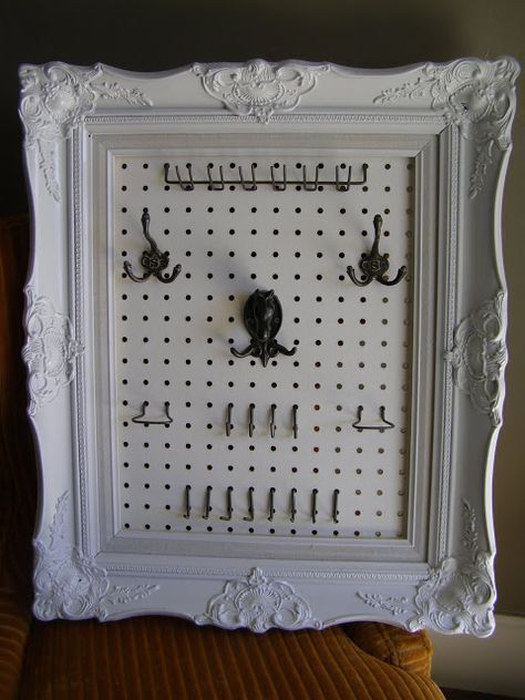 Old frame, spray paint, pegboard and pegboard hooks makes a jewelry holder!
