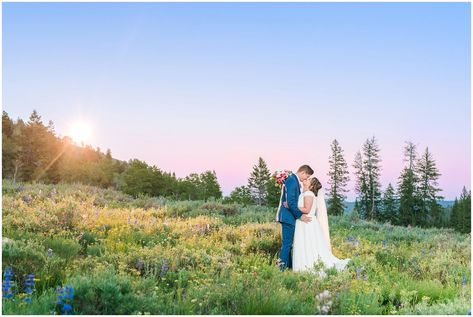 Bride and Groom during sunset in the mountains during Tony Grove Summer Formal Session | Jessie and Dallin Photography #mountainwedding #utahmountains #firstlook #tonygrove #tonygrovewedding #wildflowerwedding #rockymountainwedding #rockymountainbride #utahwedding #utahweddings #utahbride #utahbrideandgroom #sunsetwedding #formalsession #utahelopement