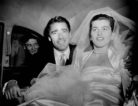 Actor Peter Lawford and his bride, the former Miss Patricia Kennedy, are all smiles as they sit in their limousine following their wedding in St. Thomas Moore Roman Catholic Church on New York's Park Avenue, April 24, 1954. The 29-year-old bride is the daughter of Joseph P. Kennedy, industrialist, philanthropist and former United States ambassador to Great Britain.