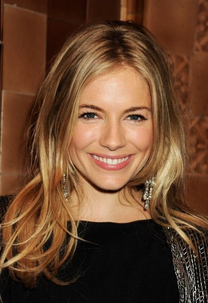 Sienna Miller's long layers, shaggy, love that it looks all undone and loose.