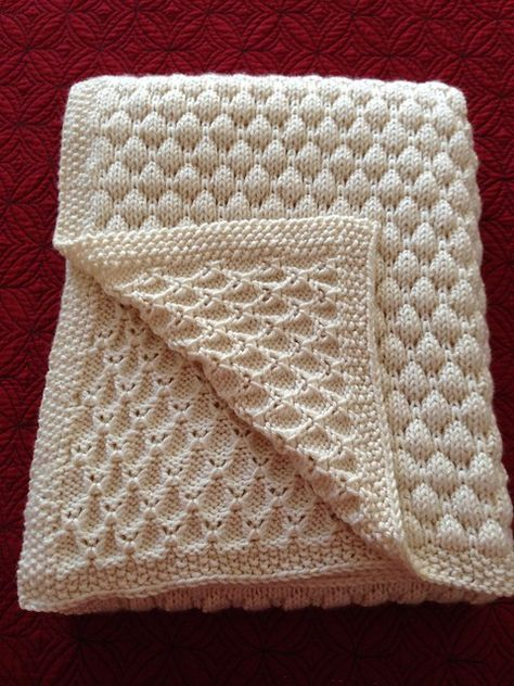 Free knitting pattern for Dean's Blanket - easy baby blanket with coin stitch Designed by Tree Crispin, this pattern can easily be modified to make it larger or smaller as well as changing the border. The coin stitch pattern is a multiple of 4 stitches plus 1.