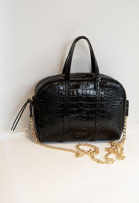 4eb575e5a2a9 The Croc Chain Duffle Bag