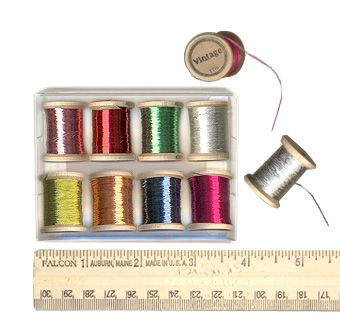 This site sells vintage buttons and things- so pretty to browse through- Metal Threads & Fabric 25.00 for 100 yards