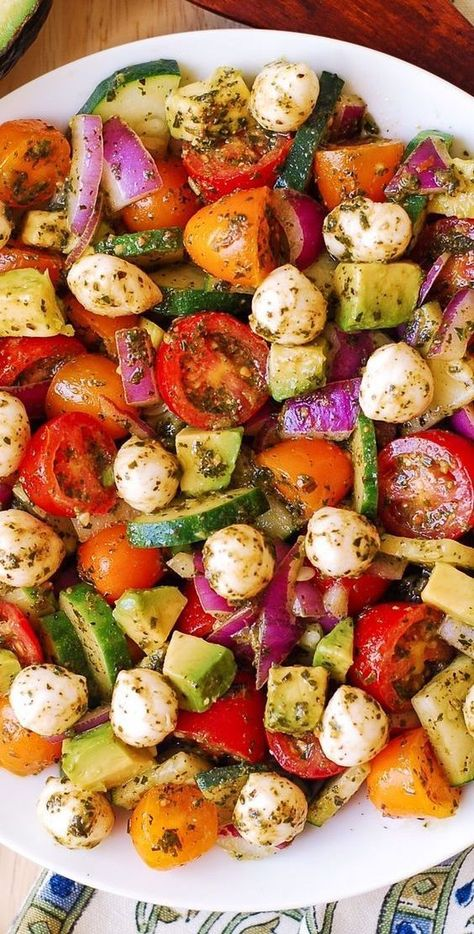 Avocado Salad with Tomatoes, Mozzarella, and Basil Pesto – healthy recipe packed with nutrients and lots of fresh ingredients!  Perfect Spring and Summer salad!   Small fresh Mozzarella cheese balls are delicious when combined with avocado in this easy salad that also features red and yellow cherry tomatoes, cucumbers, and red onions.  #avocado #salad #avocadosalad #tomatoes #cucumbers #mozzarella #basilpesto #springsalad #summersalad #healthy #healthysalad #mozzarellasalad Healthy Weeknight Dinners, Healthy Dinner Recipes, Vegetarian Recipes, Easy Salads, Summer Salads, Summer Salad Recipes, Avocado Nutrition, Tomato Nutrition, Healthy Recipes